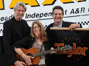 TAXI member Sylvia Winsby poses with ASCAP V.P. Ralph Murphy and TAXI's CEO Michael Laskow after winning her brand new Taylor Guitar at the 2012 TAXI Road Rally.
